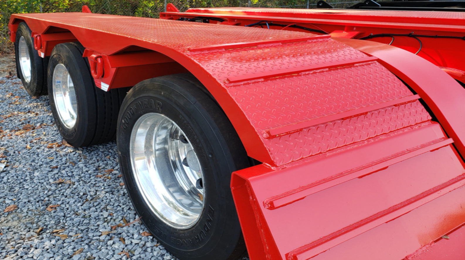 load bearing wheel covers for heavy haul trailers